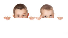 Two brothers behind white board Stock Photography