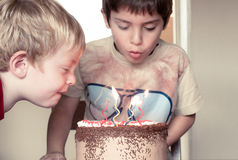 Two brothers and a Birthday cake Stock Photography