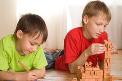 Two brothers are building Royalty Free Stock Images