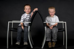 Two Brothers On A Chair Royalty Free Stock Images