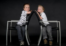 Two Brothers On A Chair Royalty Free Stock Image