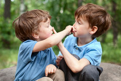 Two brothers click on  nose Stock Photo