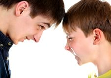 Two Brothers Confrontation. On the White Background closeup Royalty Free Stock Photography