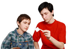 Two brothers are considering stamps Royalty Free Stock Photo