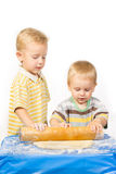 Two brothers cook dough for a pie Royalty Free Stock Images