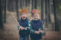 Two Brothers cuddling  in a forest on autumn day. Little kids hu Royalty Free Stock Photo