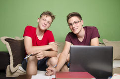 Two brothers doing homework together Stock Photo