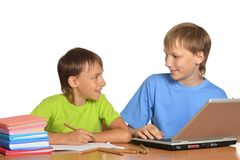 Two brothers doing homework Royalty Free Stock Image