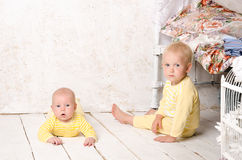Two brothers  in dress yellow Royalty Free Stock Photo