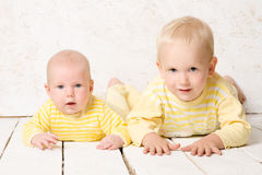 Two brothers  in dress yellow Royalty Free Stock Image