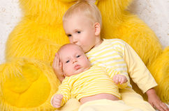 Two brothers  in dress yellow Stock Photo