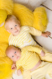 Two brothers  in dress yellow Stock Image