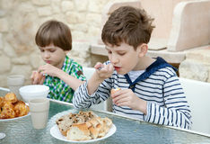 Two brothers eat healthy breakfast Stock Image