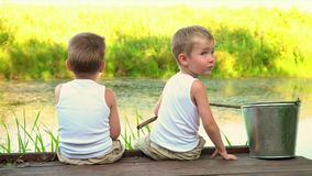 Two brothers fishing in the open air stock video footage