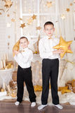 Two brothers in a gold Christmas decorations Stock Photo