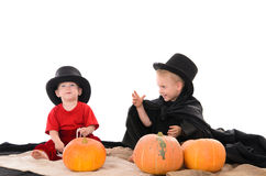 Two brothers in Halloween costumes Stock Image