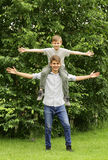 Two brothers have fun in the park - summer time Royalty Free Stock Photos