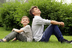 Two brothers have fun in the park - summer time Royalty Free Stock Photography