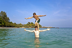 Two brothers have fun together in the ocean Royalty Free Stock Photo