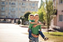 Two brothers having fun in sunny summer day, happy best friends playing.  royalty free stock image