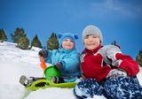 Two brothers having fun on winter day Stock Photos