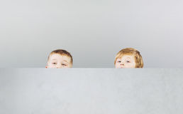 Two brothers hiding themselves during game Stock Photo