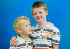 Two Brothers Holding each other. Only like brothers can Stock Photo