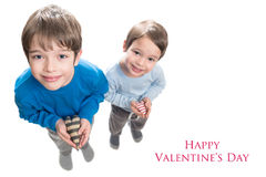 Two brothers holding heart in hands Stock Image