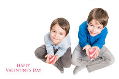 Two brothers holding heart in hands Royalty Free Stock Image
