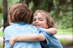 Two brothers hugging in park Royalty Free Stock Images