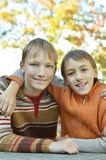 Two brothers hugging. Portrait of two brothers hugging in autumnal park stock photography