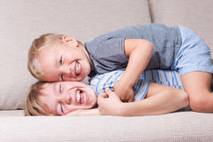 Two brothers laugh. Two  fun brothers laugh, indoor Royalty Free Stock Photos