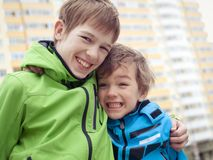 Two brothers laugh, outdoor Stock Photo