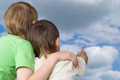 Two brothers look to the sky Royalty Free Stock Photography