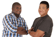 Two brothers looking at camera with arms folded Royalty Free Stock Photography