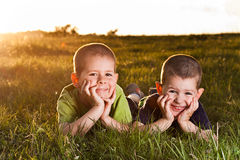 Free Two Brothers Lying On Grass Stock Photo - 24626810