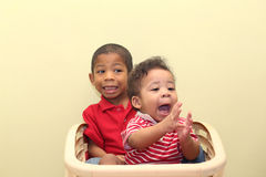 Two brothers of mixed race.  Focus in the front baby Royalty Free Stock Photography