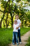 Two brothers outdoors. Two brothers are hugging outdoors in the park Royalty Free Stock Image