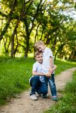 Two brothers outdoors. Two brothers are hugging outdoors in the park Stock Image