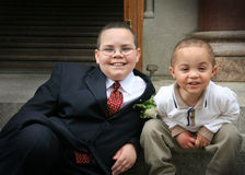 Two brothers outside a church Stock Photos