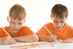 Two brothers paint Royalty Free Stock Images