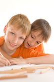 Two brothers paint Royalty Free Stock Photography