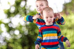 Two brothers play,have fun,make friends.Children dressed in the same clothes. Children dressed in the same clothes stock image