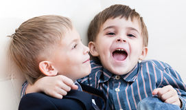 Two brothers play. One of them joyfully shouts Stock Photography