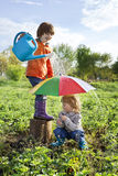 Two brothers play in rain Royalty Free Stock Image