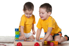 Two brothers playing blocks stock photo