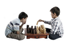 Two brothers playing chess Royalty Free Stock Photography