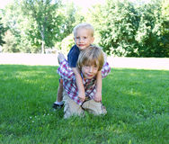 Two brothers playing in park Stock Image