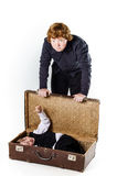 Two brothers playing with retro suitcase Royalty Free Stock Images