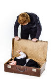 Two brothers playing with retro suitcase Stock Photos